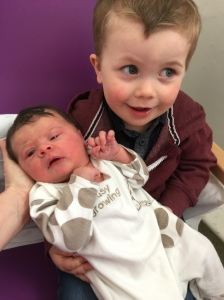 Charlie meeting his baby sister for the first time!